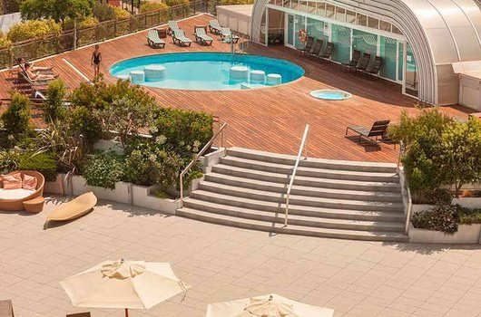 Enjoy a refreshing swim in our outdoor pool with solarium ...